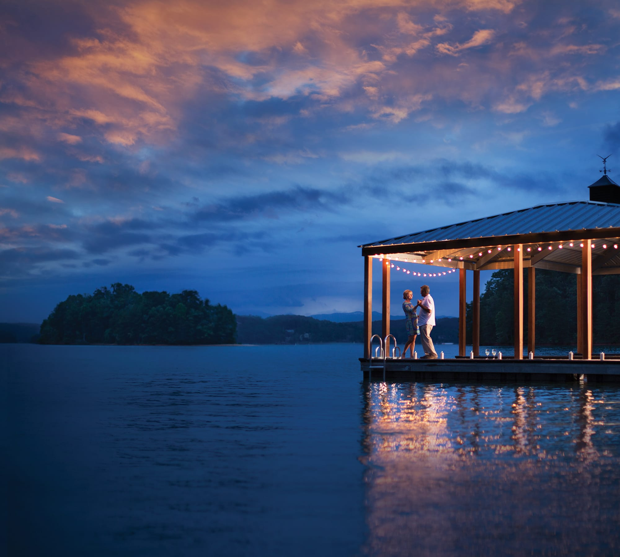 Couple dancing on the dock at Lake Keowee