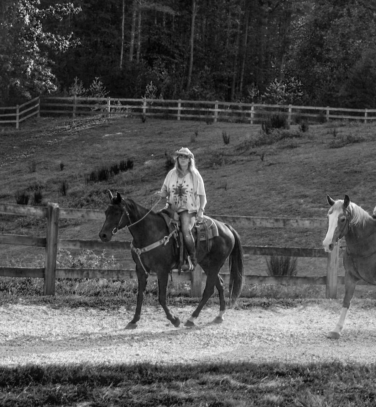 Woman riding horse at The Equestrian Center