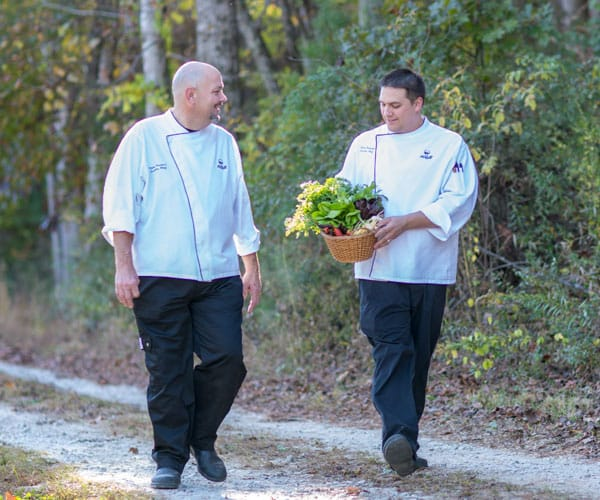 Chefs bringing back vegetables from the garden