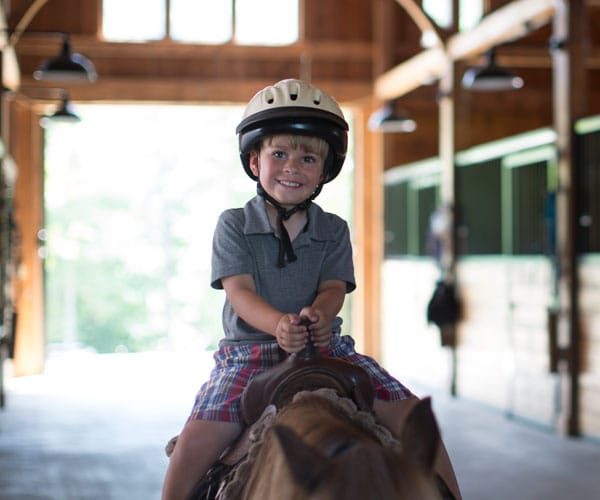 Boy on horse at The Equestrian Center