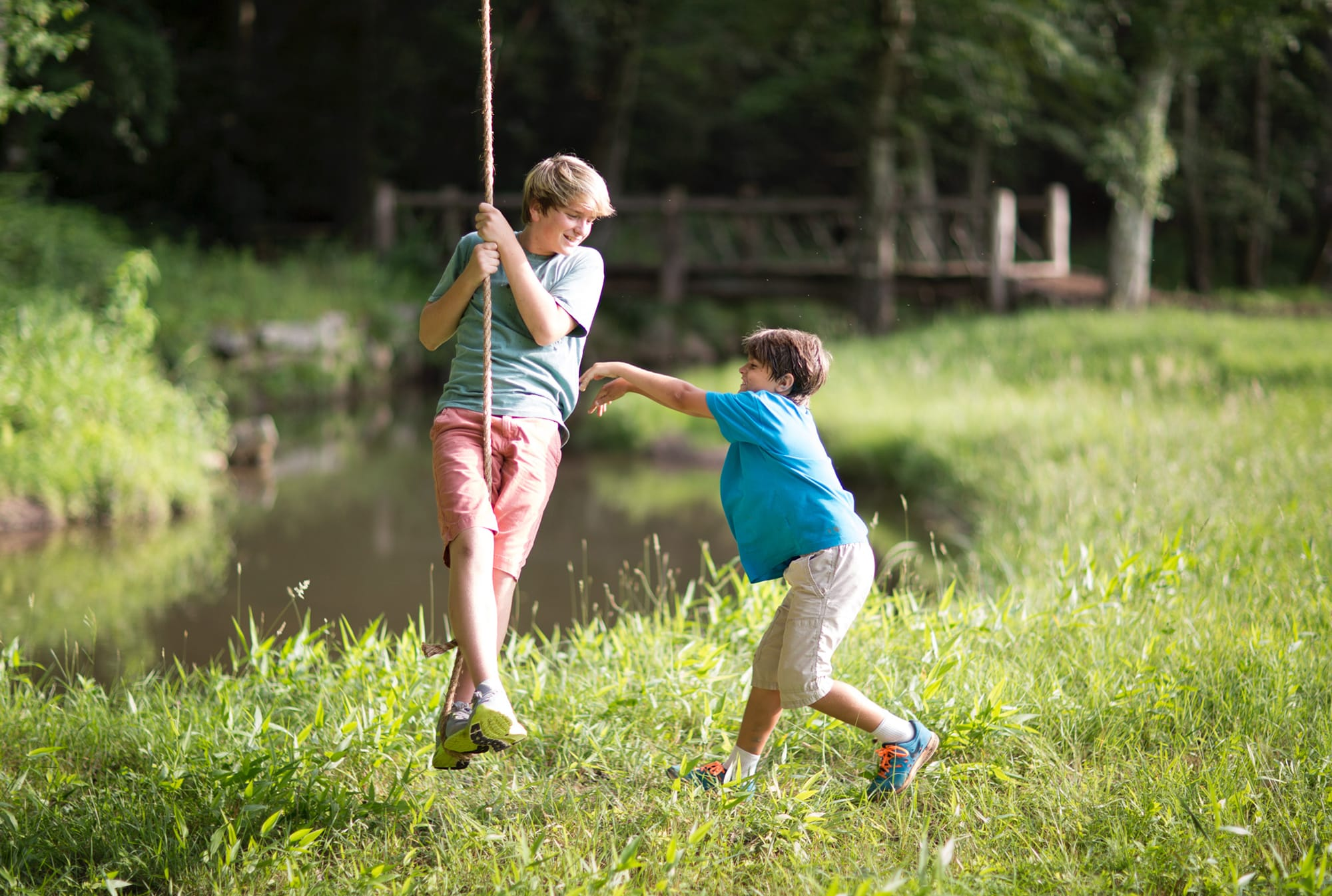 Children playing on the rope swing