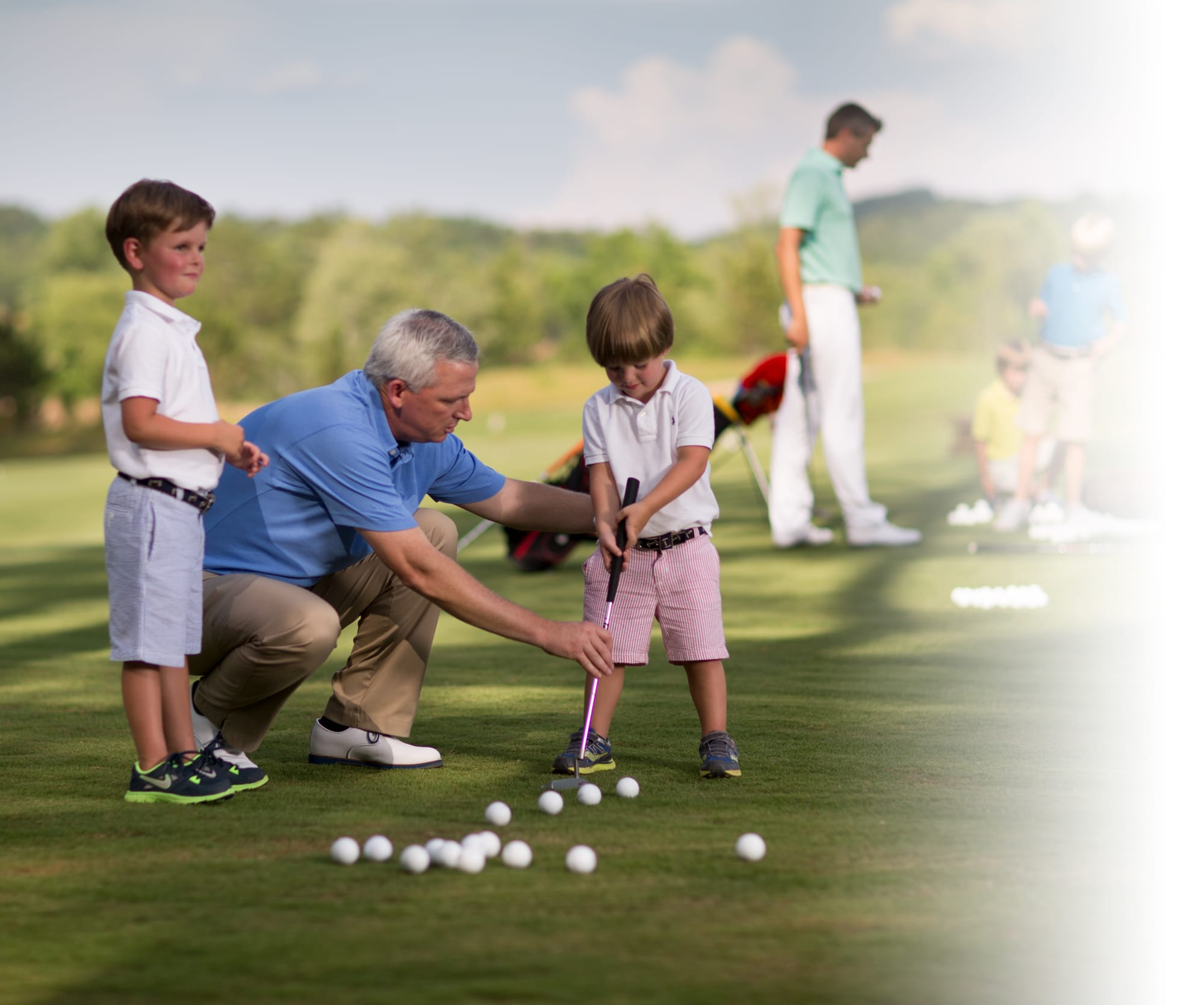 Children learning the basics of golfing