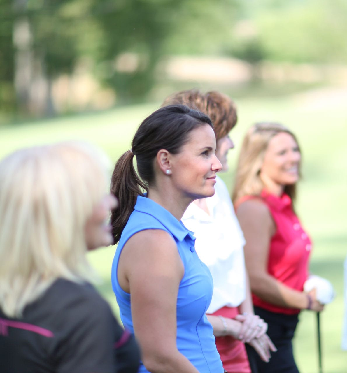 Ladies taking a golfing lesson