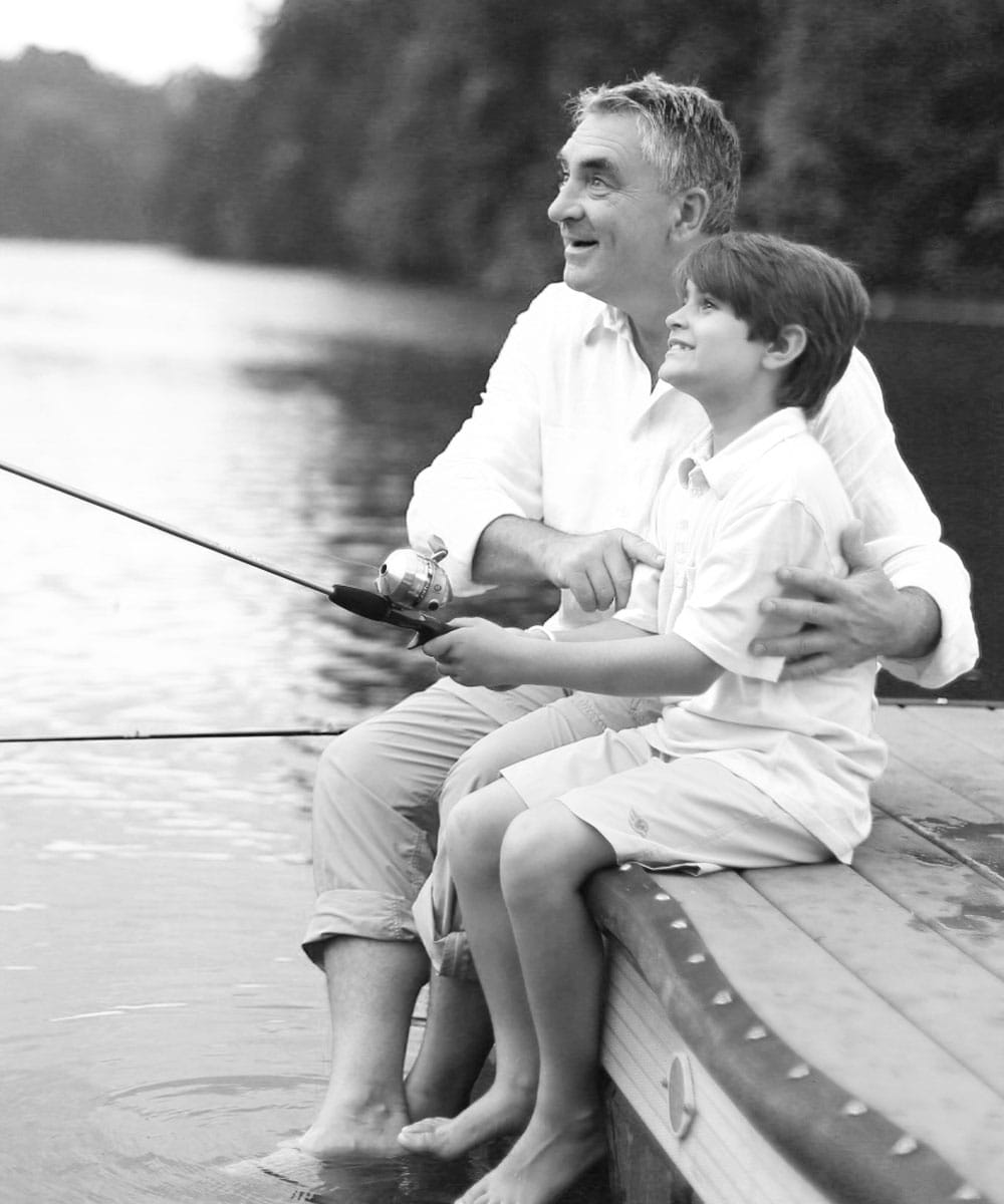 Father and son fishing off the dock at Lake Keowee