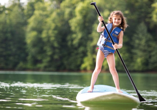 Learning how to paddleboard at an early age
