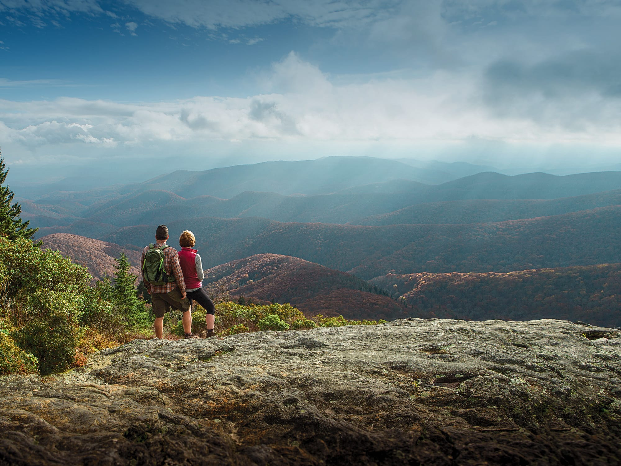 Couple taking in the mountain view after a hike