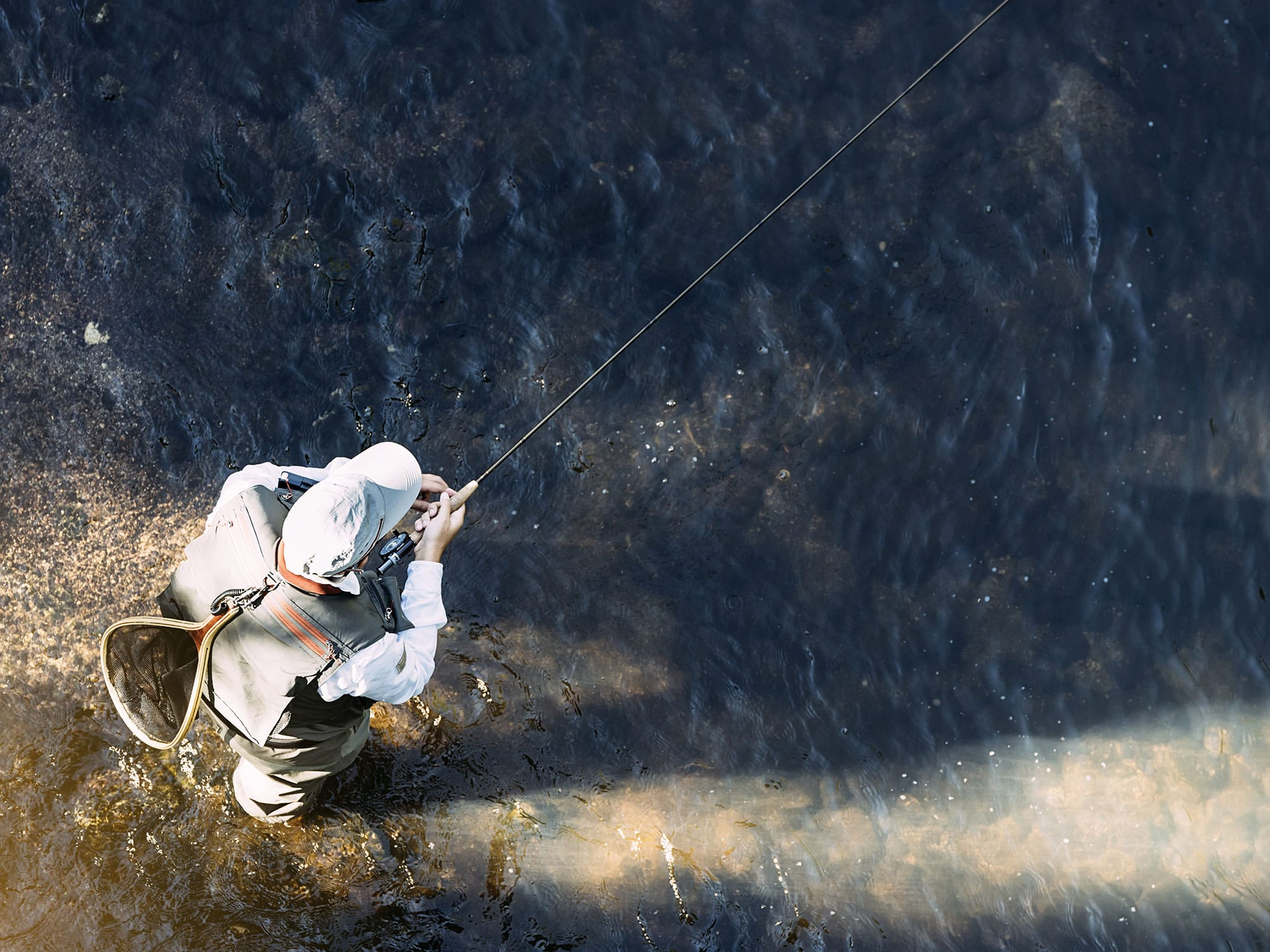 Fly fisherman in the river